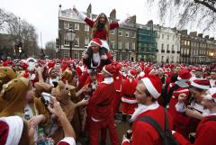 Santas take part in the Santacon event in London, England