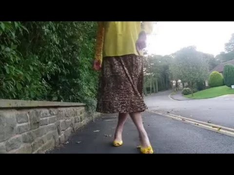 Toni Manero Al Fresco Strutting In Her Leopard Print Pleated Midi Skirt.