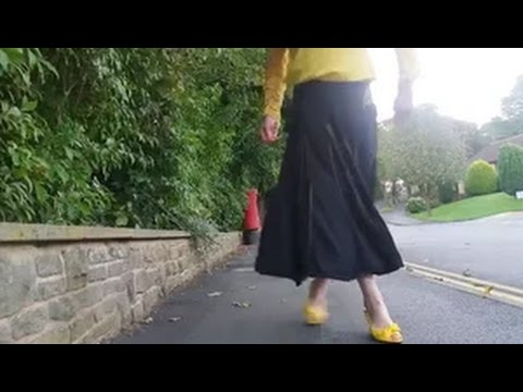 Toni Manero Al Fresco Strutting In Her Black/Gold Full Circle Midi Skirt.